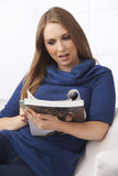 Young Woman Reading Magazine Royalty Free Stock Photography