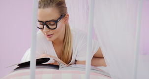Young woman reading magazine. royalty free stock photo