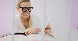 Young woman reading magazine. stock photography