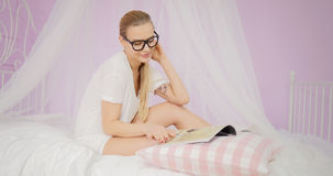 Young woman reading magazine. stock photos