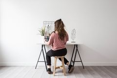 Young woman reading a magazine in her retro white room Stock Photos