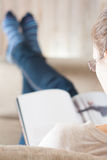 Young woman reading magazine Royalty Free Stock Images