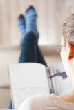 Young woman reading magazine Stock Image