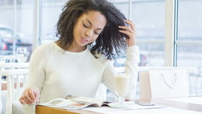 Young woman reading a magazine stock footage