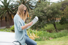 Young woman reading a map Stock Photo