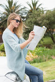 Young woman reading a map Royalty Free Stock Photo