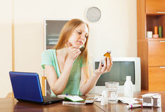Young woman reading about medications Stock Photography