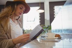 Woman reading menu in cafe Stock Images