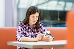 Young woman reading a message Stock Photo