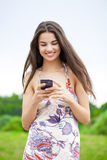 Young woman reading a message on the phone Stock Image