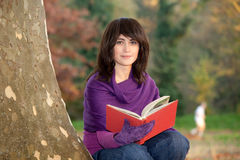 Young woman reading in nature Royalty Free Stock Photo