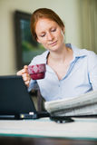 Young Woman Reading the News Stock Photography