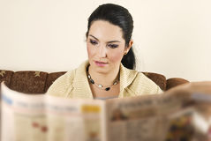 Young woman reading newspaper Royalty Free Stock Image