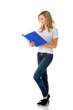 Young woman reading notes in her binder Royalty Free Stock Image