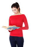 Young woman reading an old book Stock Image