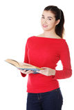 Young woman reading an old book Stock Images