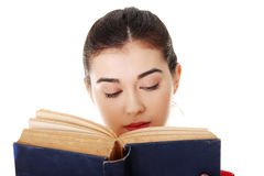 Young woman reading an old book Stock Photo