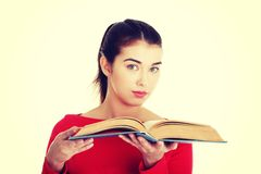 Young woman reading an old book Royalty Free Stock Photos