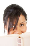 Young woman reading an old book Stock Photos