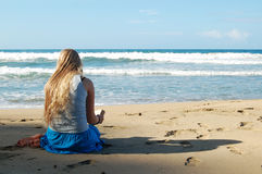 Young Woman Reading On Beach Royalty Free Stock Images
