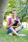 Young woman reading outdoor Stock Photos