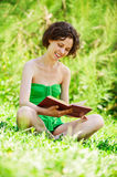 Young woman reading outdoors Royalty Free Stock Photography