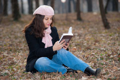 Young Woman Reading Outdoors Stock Photos