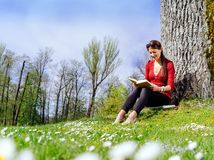 Young woman reading outdoors Royalty Free Stock Photo