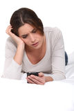 Young woman reading an sms Royalty Free Stock Photography