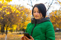 Young woman reading an sms on her mobile Royalty Free Stock Photo