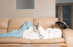 Young woman reading on sofa Royalty Free Stock Photo