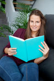 Young  woman reading on the sofa Royalty Free Stock Image