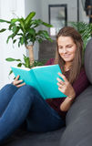 Young  woman reading on the sofa Royalty Free Stock Photo