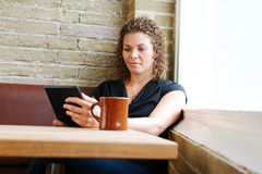 Young woman reading from tablet Stock Photo