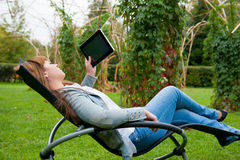 Young woman reading in tablet pc Stock Image