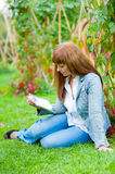 Young woman reading in tablet pc Royalty Free Stock Photography