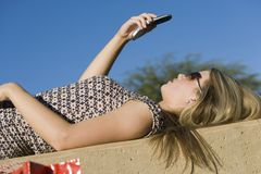 Young Woman Reading Text Message Stock Photo