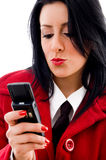 Young woman reading a text message Royalty Free Stock Image