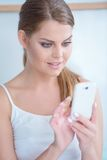 Young woman reading a text message on her mobile Stock Photo
