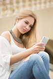 Young woman reading a text message. on the street Stock Images