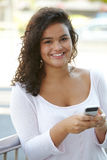 Young Woman Reading Text Message In Urban Setting Stock Image