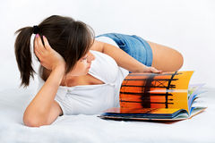Young woman reading travel magazine Royalty Free Stock Photo