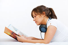 Young woman reading travel magazine Stock Image