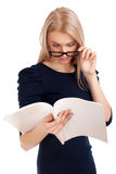 Young woman reading womens magazine Stock Image