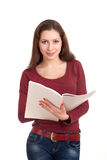 Young woman reading womens magazine Stock Images