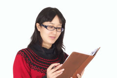 Young woman reads book. Royalty Free Stock Images