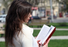 Young woman reads book Stock Photo