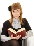 Young woman reads a book Stock Photo
