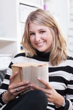 Young woman reads a book Royalty Free Stock Photos