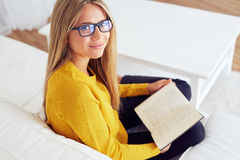 Young woman reads a book stock images